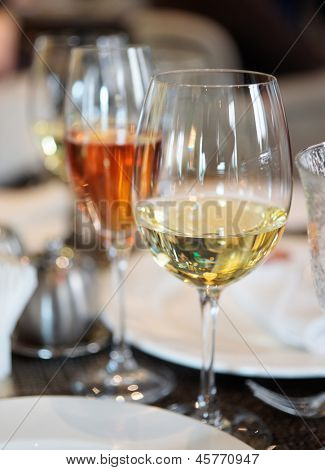 White wine and pink champagne on restaurant table