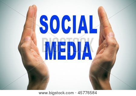 man hands forming brackets and the words social media written in blue inside