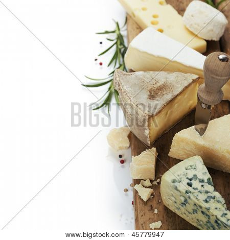 various cheeses on the wooden board