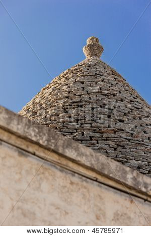 Ancient residential structures known as Trulli found in Alberobello in the south of italy poster