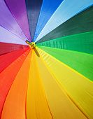 Colorful close up abstract of rainbow umbrella poster