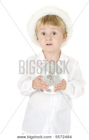 Angelic Boy With Santa Hat Holds Snow Globe