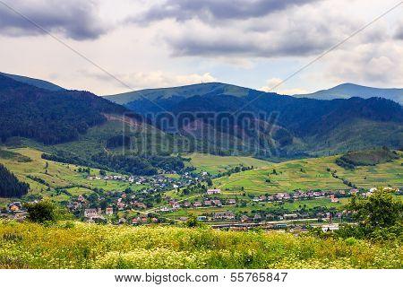 Light  Beam Falls On Hillside With Autumn Village In Mountain