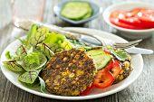 Vegan chickpeas burgers with salad and vegetables poster
