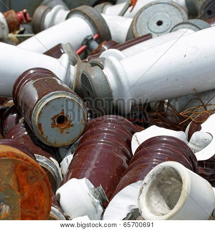 Many Pieces Of Iron And Ceramic Electrical Insulators In An Industrial Waste Landfill