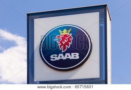 Samara, Russia - May 24, 2014: The Emblem Saab Over Blue Sky. Saab Automobile Ab Is A Swedish Premiu