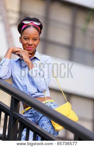 Stock image woman smiling from a staircase