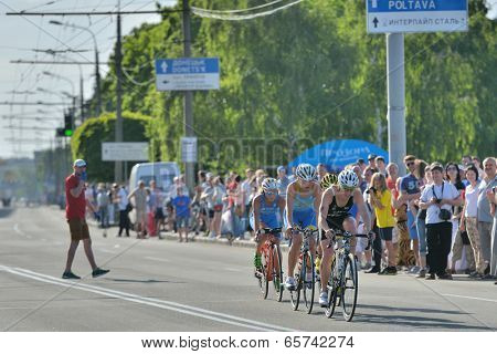 DNEPROPETROVSK, UKRAINE - MAY 24, 2014: Leading group of female athletes race on the second stage of ETU Sprint Triathlon European cup. It's the first time Triathlon European Cup take place in Ukraine