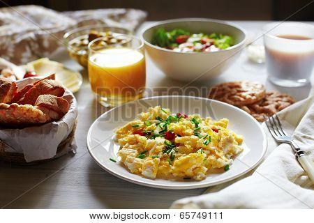 Fresh Breakfast Food. Scrambled Eggs And Orange Juice.
