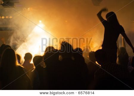 photo of hands at rock concert silhouettes against stage lighting poster