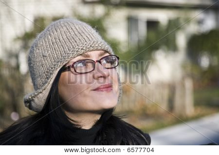 Girl in Glasses and Funny Hat