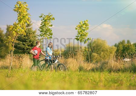 Mountain Bikers Having A Strall In Summer Forest