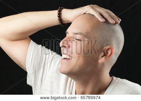 Man Feels Newly Shaved Head