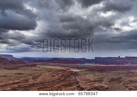 Dark Dramatic clouds and beautiful views from the Hurrah Pass Trail poster