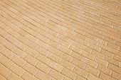 Background texture of yellow cobblestone pavement pattern poster