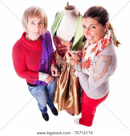 Two Women Working On A Dress