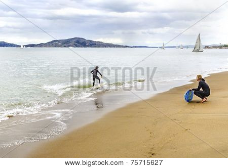 Skimboarding In San Francisco Bay, California