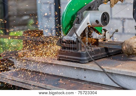 Industrial Worker Cutting Metal
