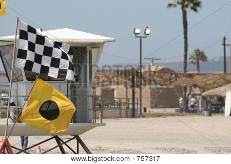 A partial photo of a life gaurd tower in Oceanside. poster