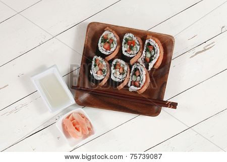 fresh sushi sashimi nigiri with raw salmon slice red ginger and japanese vinegar on wooden plate over white table high resolution hidef
