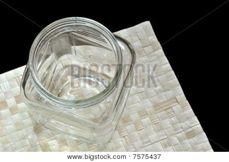 Wide mouth bottle on grass mat