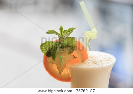 Milk cocktail with orange and carom