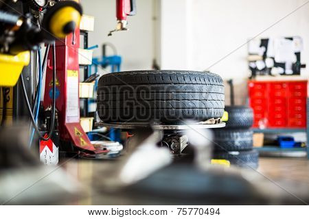 Inside a garage - changing wheels/tires (shallow DOF; color toned image)
