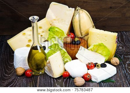a mixed group of different type of cheese on wood