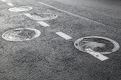 Sewer manholes on the asphalt road pavement poster