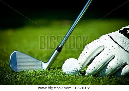 White glove, golf ball and iron