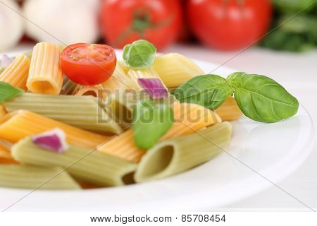 Colorful Penne Rigate Noodles Pasta Meal With Tomatoes And Basil On Plate