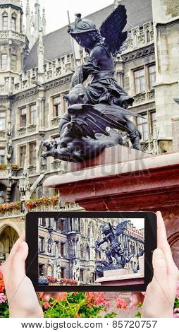 Tourist Takes Picture Of Sculpture On Mary Column