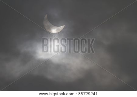 Partial Solar Eclipse Seen Through A Hole In The Clouds