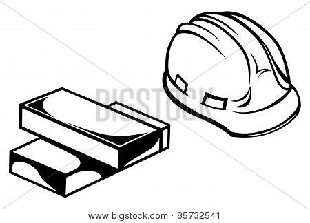 Hard hat and bricks