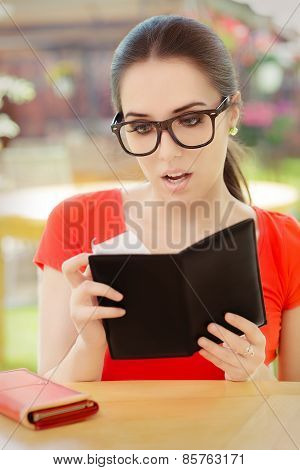 Surprised  Woman Checking Restaurant Bill