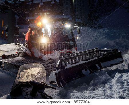 Snowcat preparing a at night in high mountains at skiing resort of the North Caucasus Elbrus poster