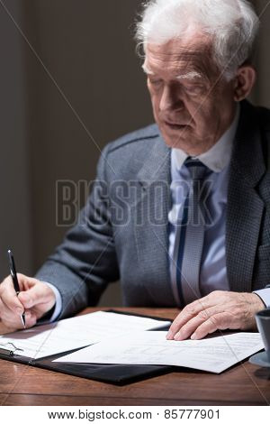Aged Businessman Doing Paperwork