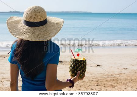 Woman Enjoying Pineapple Drink On Sunny Day