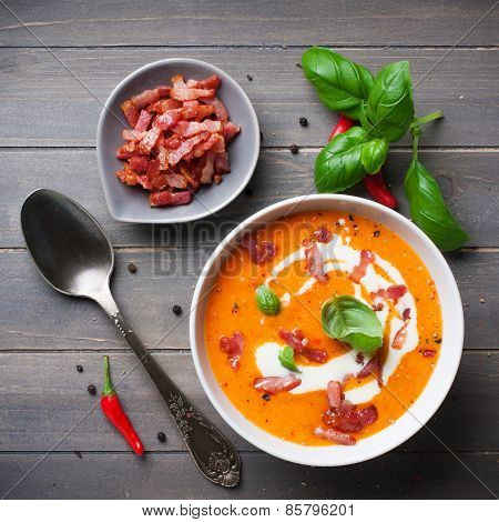 Carrot sweet pepper cream soup with bacon
