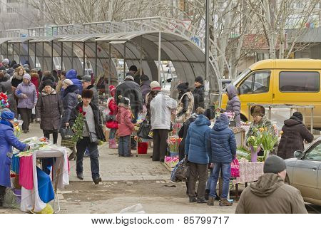 Selling flowers at a makeshift flower markets on the eve of international women's day