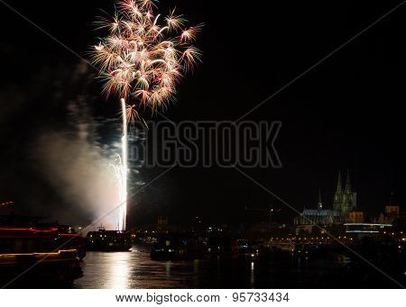 Colourful Firework In Front Of The Cathedral Of Cologne