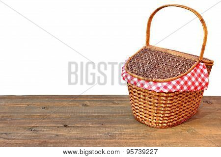 Picnic Basket On The Outdoor Wood Table Isolated Close-up