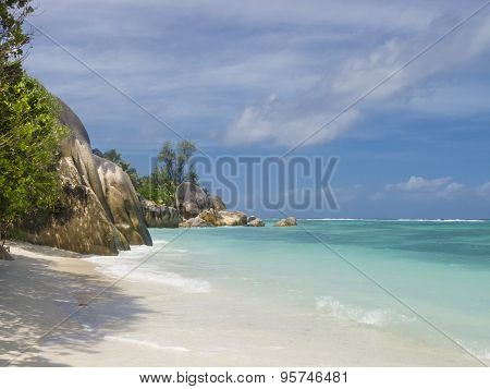 Pristine Tropical Beach Surrounded By Granite Boulders