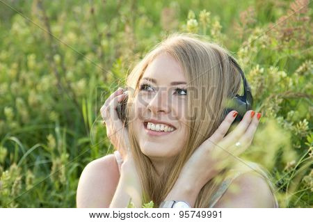 Girl On Meadow Listening To Music