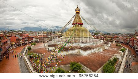 Boudhanath Stupa And Adjacent Buildings In Kathmandu Of Nepal Against Cloudy Sky From Above