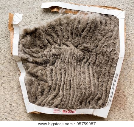 HVAC air conditioning filter clogged with dust and dirt and falling to pieces after not being changed frequently poster
