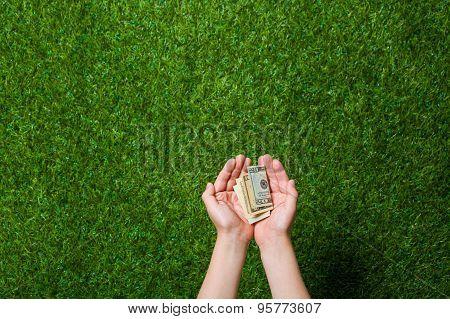 Human hands holding money
