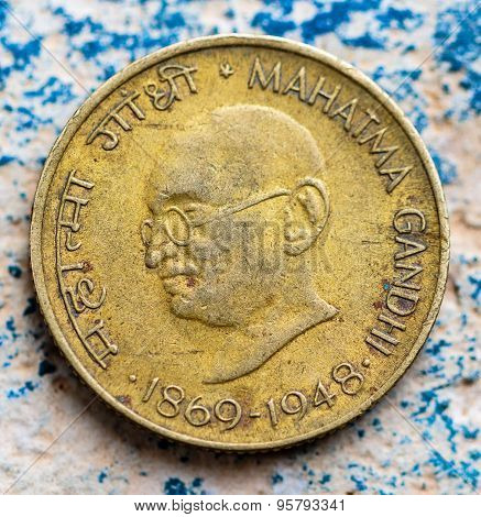 An antique Indian coin or currency showing Mahatma Gandhi lifespan 1869-1948