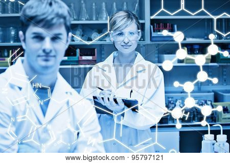 Science graphic against two assertive scientists looking at the camera standing