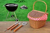 Weekend Summer Outdoor BBQ Grill Party Ot Picnic Conceptual Scene With Picnic Wood Table BBQ Tools Hamper And Open Grill Appliance On The Backyard Lawn In The Background poster